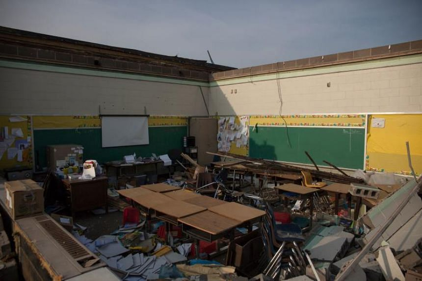 Tornadoes in western Ohio killed one and injured several others as neighbourhoods were strewn with wreckage.