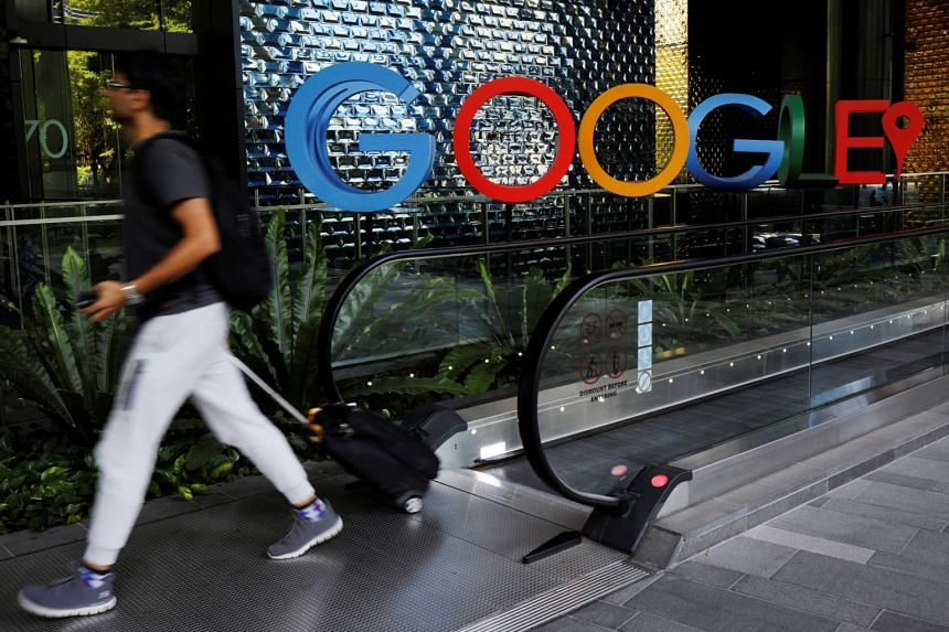 A man passes a Google signage outside their office in Singapore, on May 24, 2019.