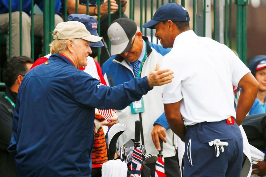 Golf legend Jack Nicklaus (left) with golfer Tiger Woods during the Singles matches for the 2013 Presidents Cup golf tournament at Muirfield Village Golf Club in Dublin, Ohio in October 2013.