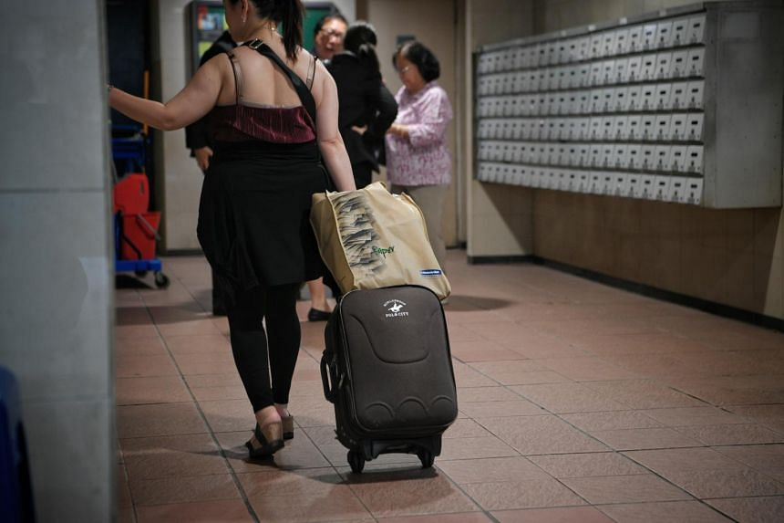 Woman with a luggage at the lift lobby of People's Park Centre, on May 17, 2019.