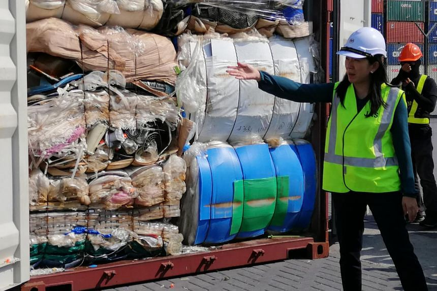 Malaysia's Energy, Science, Technology, Environment and Climate Change Minister Yeo Bee Yin showing containers filled with illegally imported plastic trash.