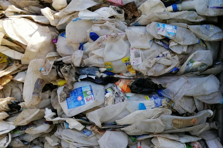 Plastic milk cartons from Australia are that have been sent to Malaysia illegally.