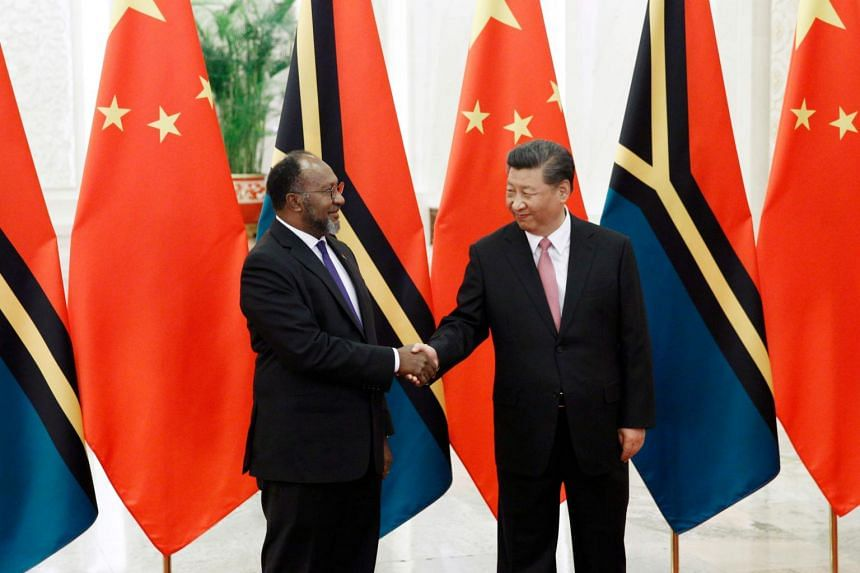 Vanuatu Prime Minister Charlot Salwai and Chinese President Xi Jinping shake hands at the Great Hall of the People in Beijing, on May 28, 2019.