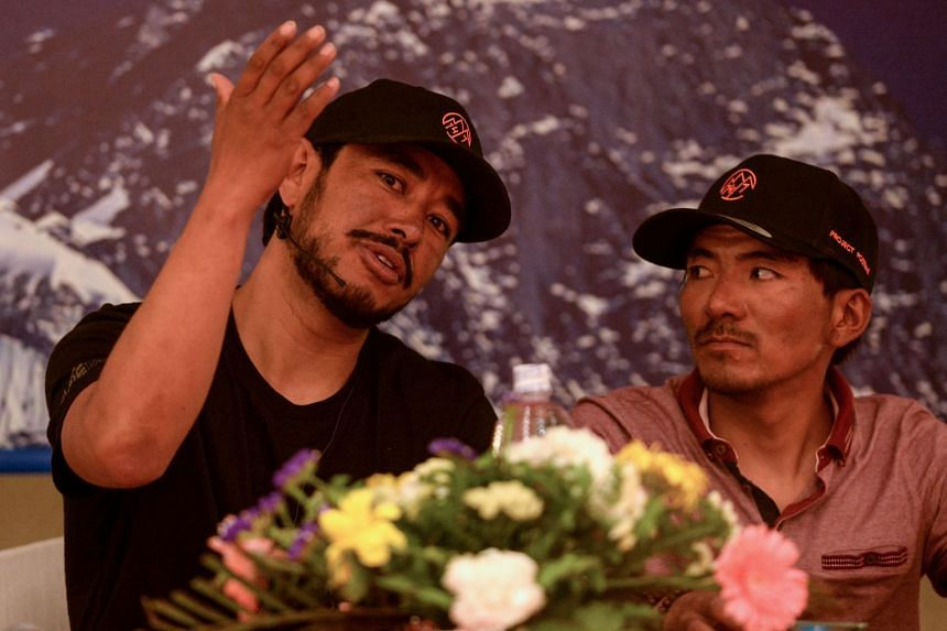 Mountaineers Nirmal Purja (left) and Mingma David Sherpa during a press conference in Kathmandu on May 28, 2019