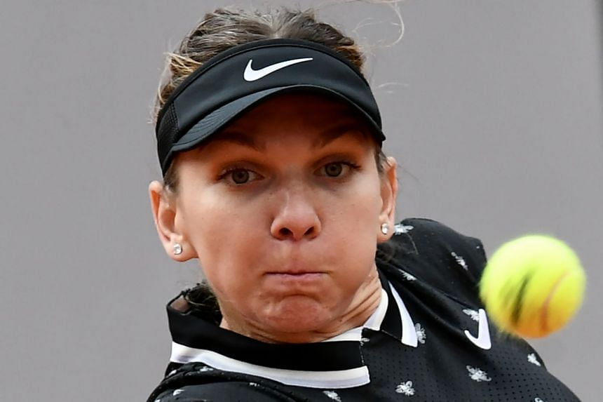 Halep eyes the ball as she hits a return to Croatia's Ajla Tomljanovic.