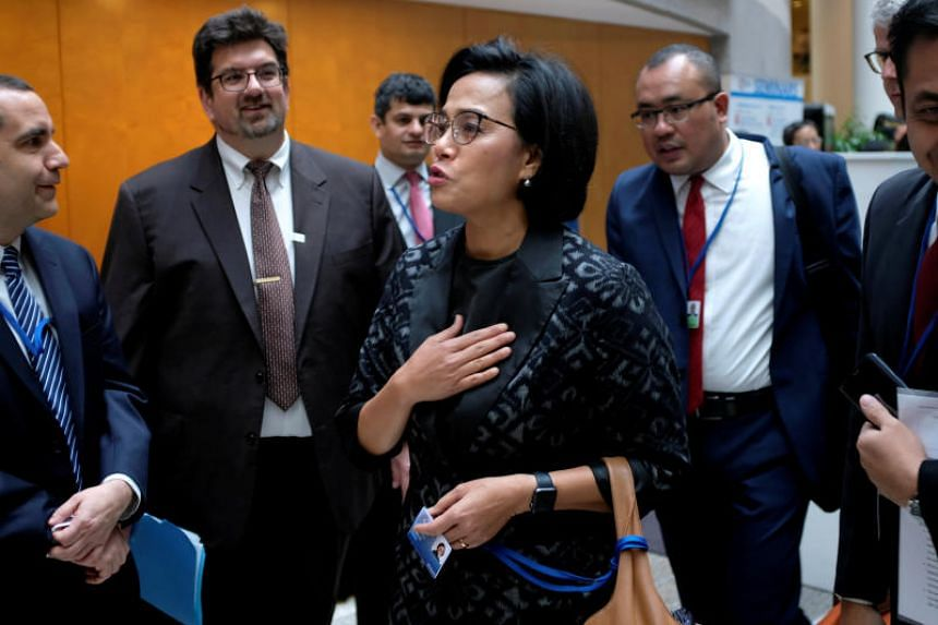 Indonesian Finance Minister Sri Mulyani Indrawati (centre) will likely remain in President Joko Widodo's cabinet and is being considered for a more senior role with oversight of his economic team.