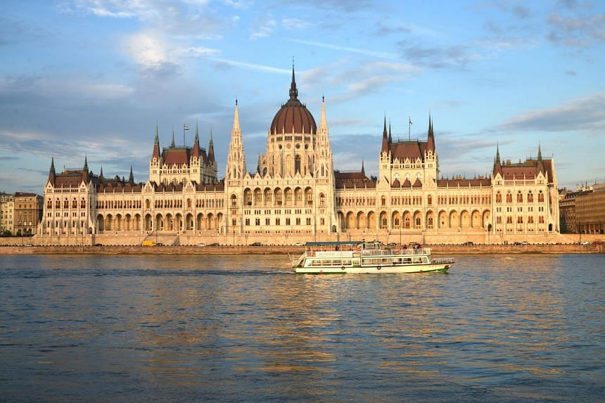 The boat was moored near the Hungarian Parliament building (above) and reportedly was hit by a another tourist vessel.