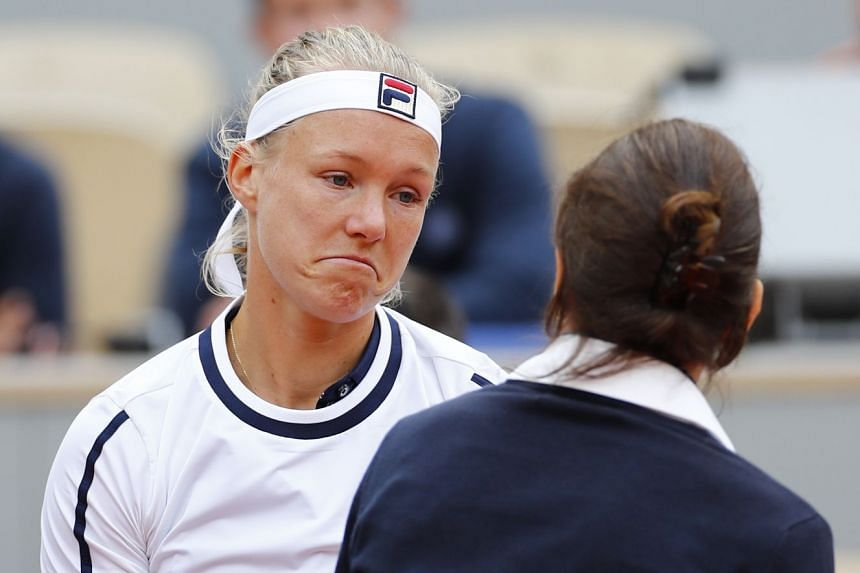 Bertens reacts as she receives medical attention during her second-round match against Slovakia's Viktoria Kuzmova.