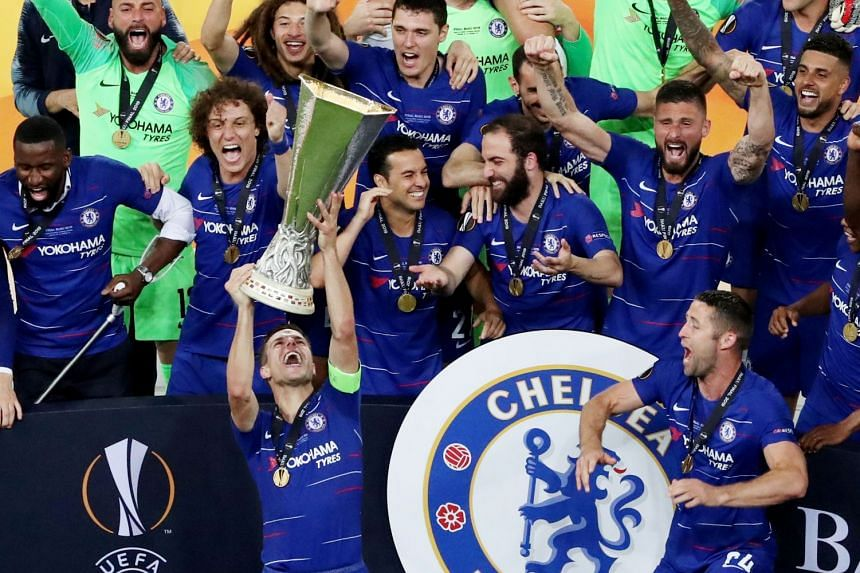 Chelsea's Cesar Azpilicueta and team mates celebrate winning the Europa League with the trophy.