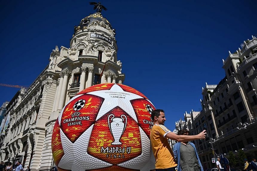 A fan taking a selfie yesterday with a giant replica of the Champions League ball displayed in Madrid ahead of Saturday's final.
