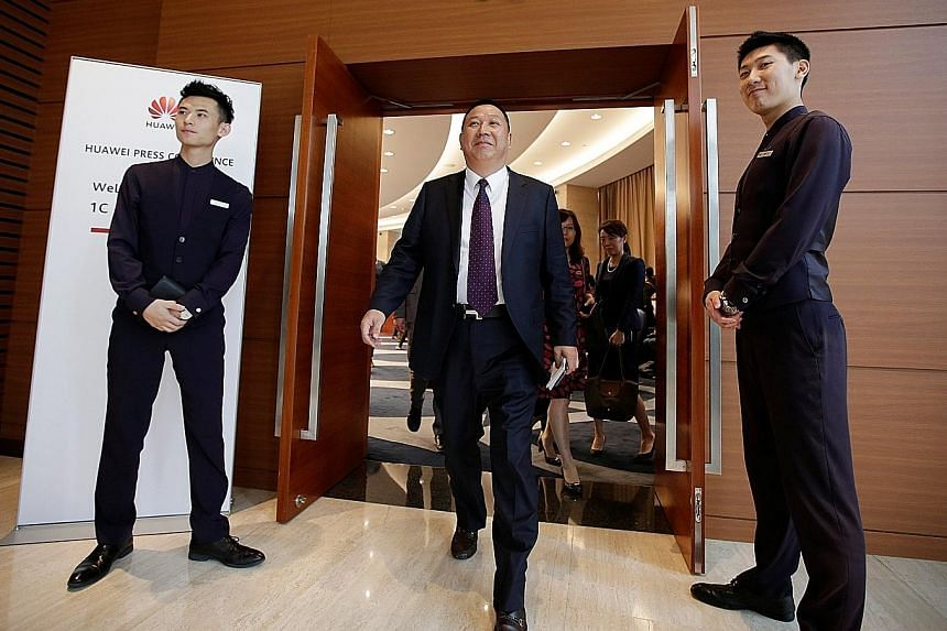 Huawei chief legal officer Song Liuping leaving after a news conference on the firm's ongoing legal action against the US government's National Defence Authorisation Act, at its headquarters in Shenzhen yesterday.