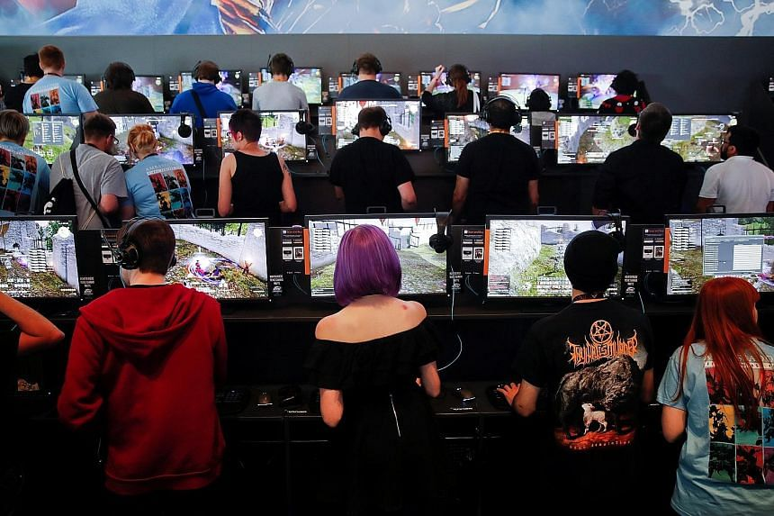 Gamers at the 2017 edition of gamescom in Cologne, Germany. Held there yearly since 2009, the festival is a highlight of the gaming world and the industry's largest event measured by exhibition space and visitor numbers. The Asian edition in Singapor