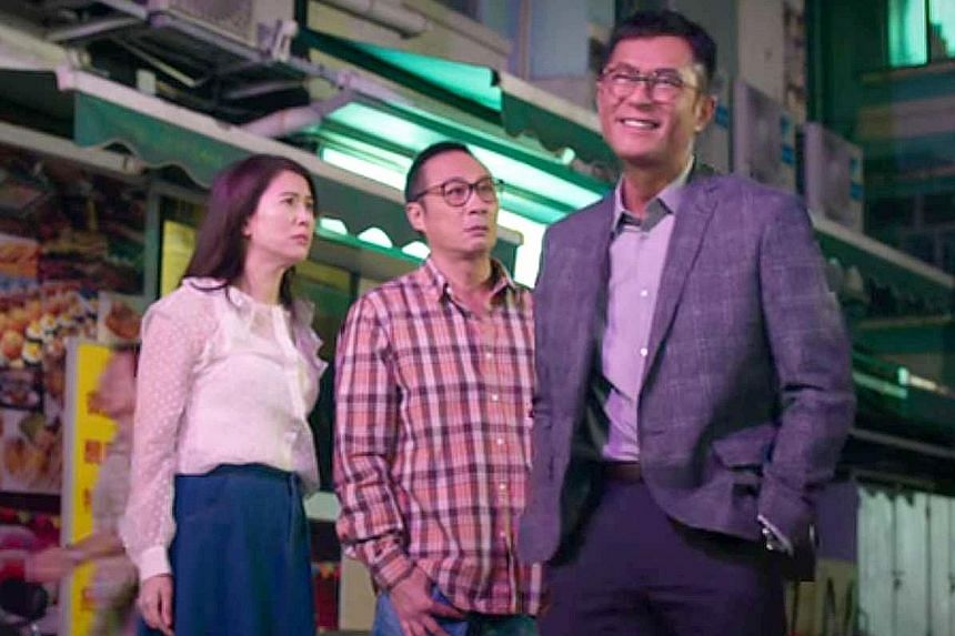 Mr Lo (Francis Ng, centre) and his wife (Anita Yuen, left) gets into a bureaucratic battle with a new neighbour (Louis Koo, right) when he erects a billboard that blocks their apartment's view of the sea.