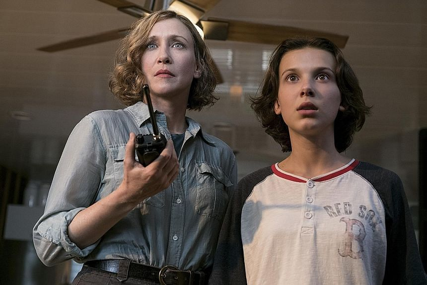 In Godzilla II King Of The Monsters, paleobiologist Emma Russell (Vera Farmiga, left) - with her daughter, Maddie (Millie Bobby Brown) - attempts to control Godzilla and other monsters using sound waves.
