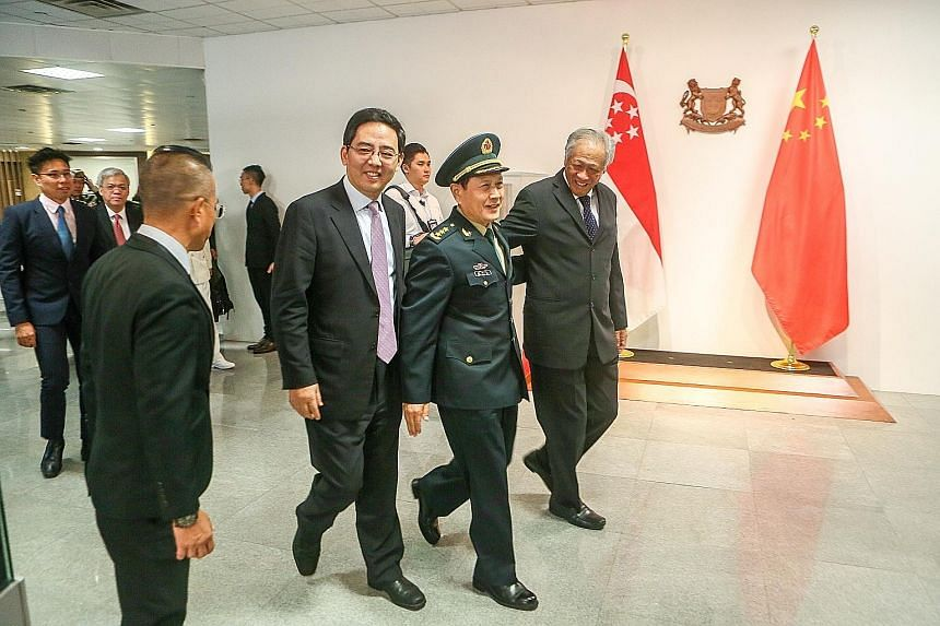 Chinese Defence Minister Wei Fenghe, flanked by his Singapore counterpart Ng Eng Hen (right) and Chinese Ambassador to Singapore Hong Xiaoyong, at the Ministry of Defence yesterday. Both ministers agreed on a substantial programme to deepen defence t