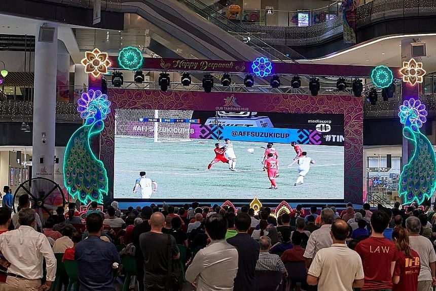More than 1,000 fans turned up at Our Tampines Hub (OTH) in November last year to watch a live screening of Singapore's AFF Suzuki Cup group match with the Philippines. OTH will screen the Champions League final on Sunday morning. ST FILE PHOTO