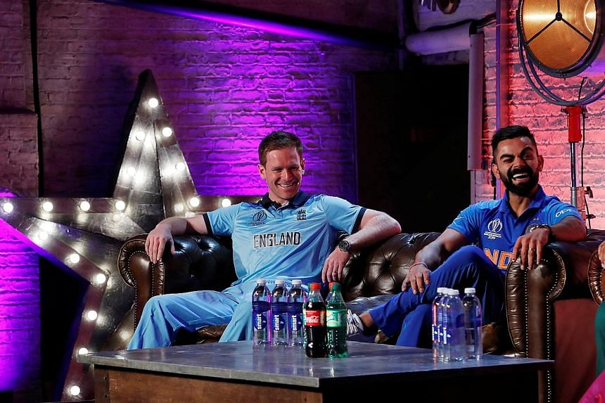 England captain Eoin Morgan and his Indian counterpart Virat Kohli at a press conference last week in London. The hosts are the title favourites, with the 2011 champions right behind them in the betting stakes. PHOTO: REUTERS
