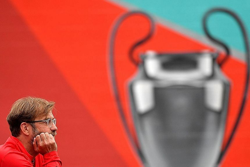 Liverpool manager Jurgen Klopp speaking about the Champions League final during a press conference at the club's Melwood training ground on Tuesday. In Madrid on Saturday, the Reds will play Tottenham. PHOTO: AGENCE FRANCE-PRESSE