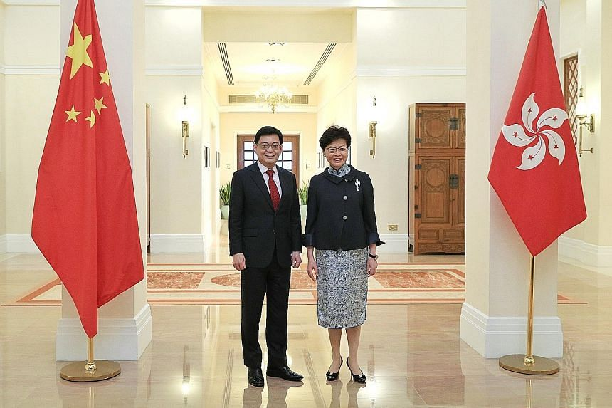 Deputy Prime Minister Heng Swee Keat met Hong Kong Chief Executive Carrie Lam yesterday. They said Singapore and Hong Kong have many common interests and cooperate well in areas such as education and finance. PHOTO: MINISTRY OF COMMUNICATIONS AND INF