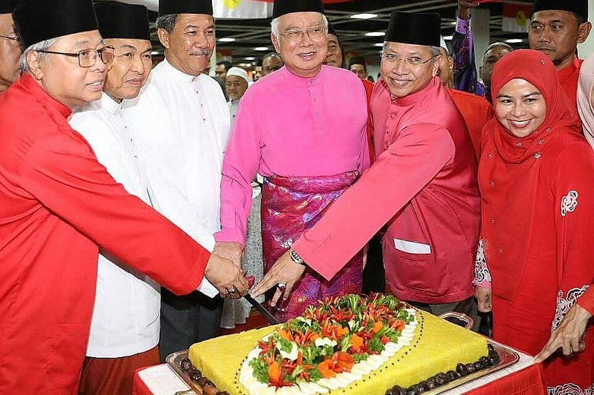 Umno stalwarts, including former prime minister Najib Razak (centre), acting Umno president Mohamad Hasan (third from left) and former deputy prime minister Ahmad Zahid Hamidi (second from left), celebrating the party's 73rd anniversary in Kuala Lump