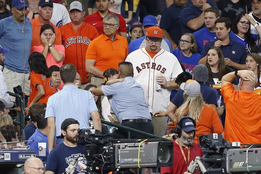 A young child is rushed from the stands after being injured by a hard foul ball at Minute Maid Park, on May 29, 2019, in Houston, Texas.