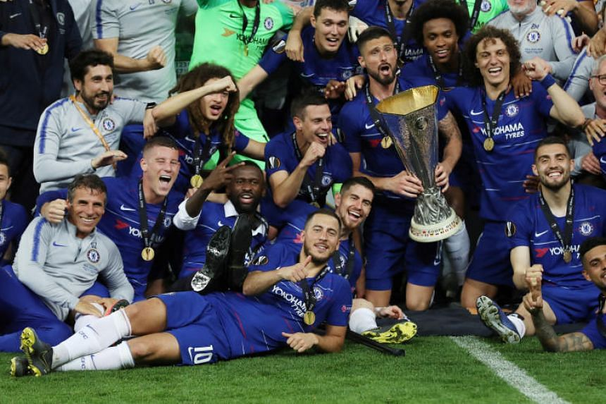 Chelsea's Olivier Giroud celebrates with the trophy alongside Eden Hazard and team mates after winning the Europa League.