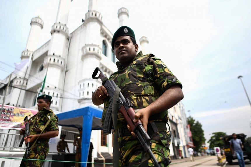 Soldiers stand guard outside a mosque ahead of Friday noon prayers in Colombo in April 2019.