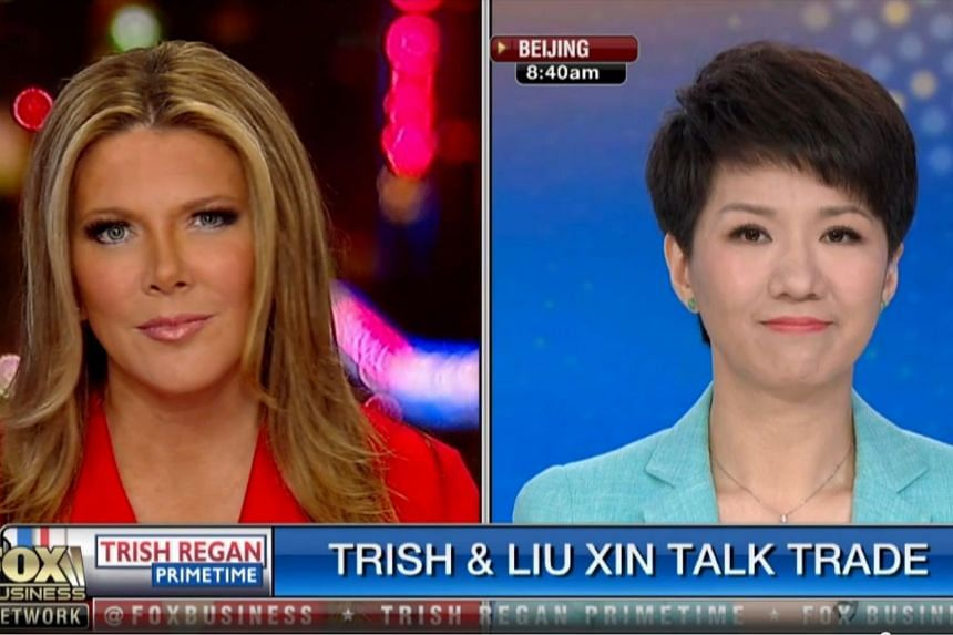 TV hosts Trish Regan and Liu Xin facing off on prime time television in the United States.