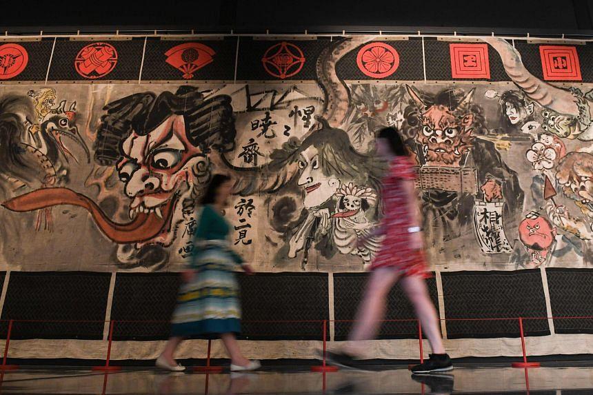 Displays include a historic manga theatre curtain (above) painted by Japanese artist Kawanabe Kyosai and an artwork of the manga series Dragon Ball by Akira Toriyama.