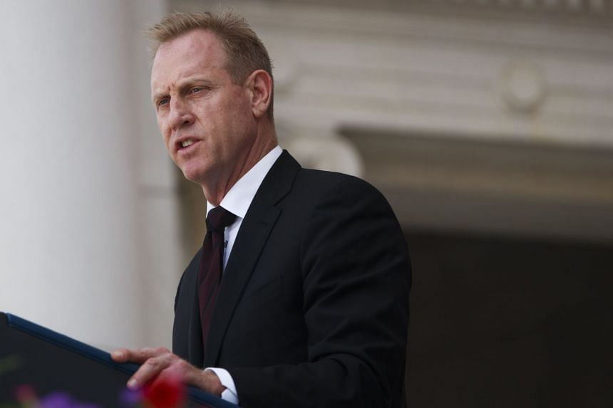 Acting US Defence Secretary Patrick Shanahan delivers remarks during a Memorial Day ceremony in Arlington, Virginia, on May 27, 2019.