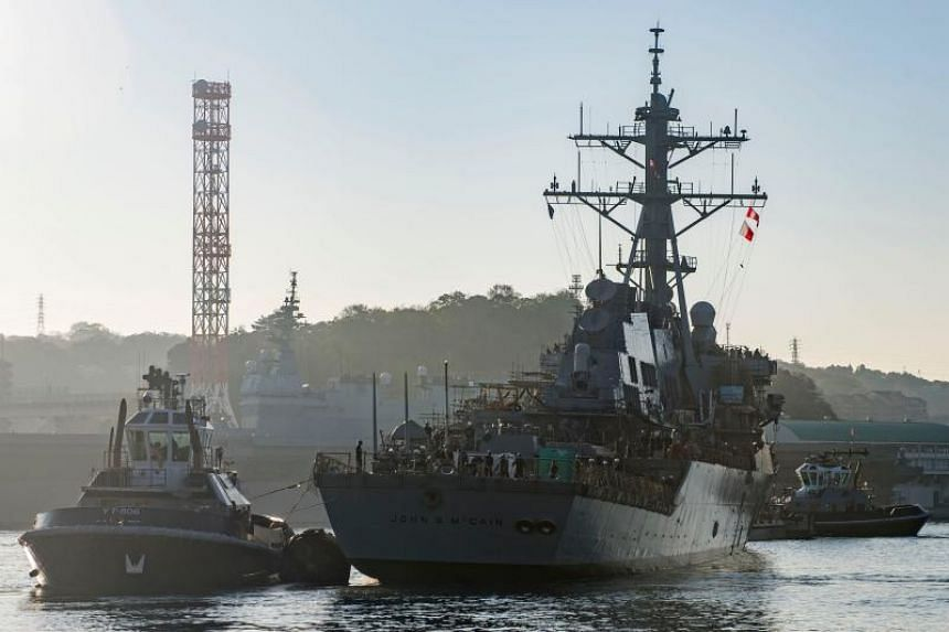 The USS John S. McCain being pulled towards a pier after departing from a dry dock at Fleet Activities Yokosuka, Japan, on Nov 27, 2018.