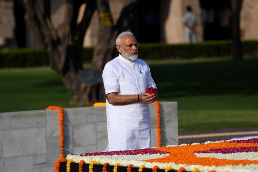 India's Prime Minister-designate Narendra Modi pays tribute at Rajghat, the memorial for Mahatama Gandhi, ahead of his swearing-in in New Delhi on May 30, 2019.