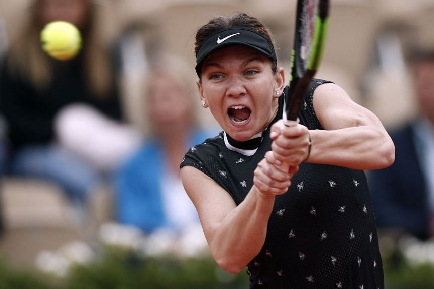 Halep in action against Magda Linette of Poland.
