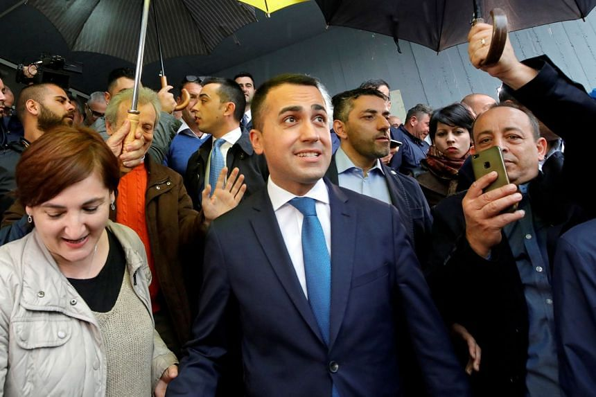 Italian Deputy Prime Minister and 5-Star Movement leader Luigi Di Maio leaves after casting his vote in the European elections.
