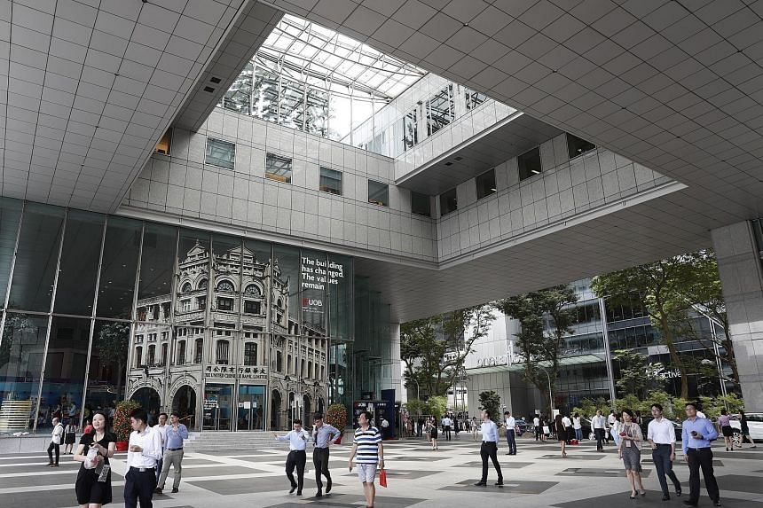 UOB PLaza in Raffles Place. For its expansion in the region, the bank is planning to use digital technology and artificial intelligence, rather than acquisitions, says its chief executive officer Wee Ee Cheong.