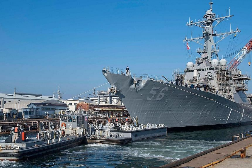 "The guided missile destroyer USS John S. McCain in Japan. The Wall Street Journal reported that the White House wanted the US Navy to move the ship ""out of sight"" during President Donald Trump's recent visit to a site nearby."