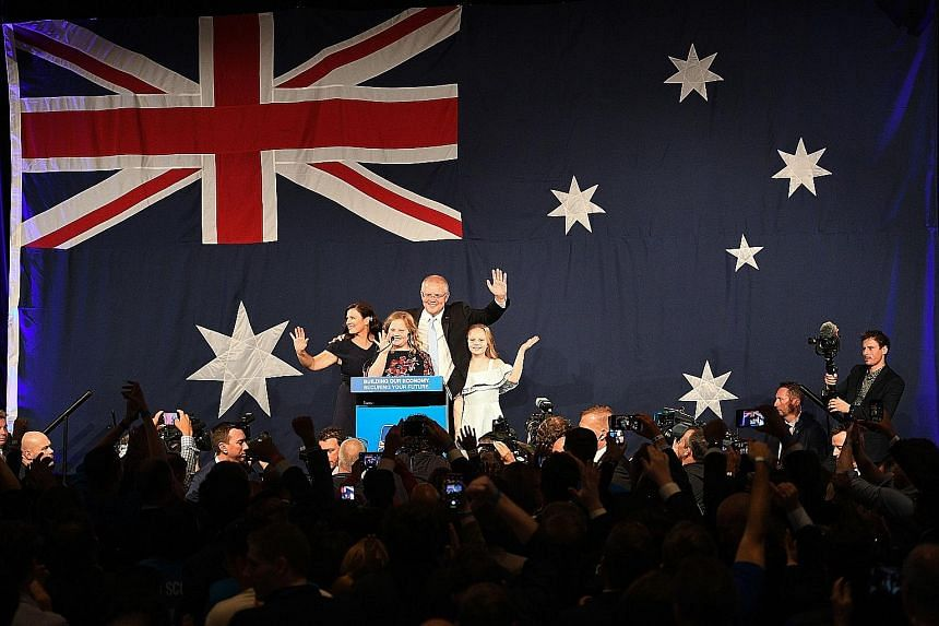 Australia's Prime Minister Scott Morrison, with his family, facing the press and supporters after his surprise win in the May 18 election. PHOTO: AGENCE FRANCE-PRESSE