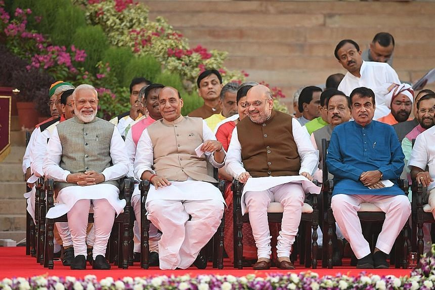 (Front row, from left) Indian Prime Minister Narendra Modi, former home minister Rajnath Singh, Bharatiya Janata Party president Amit Shah and former transport minister Nitin Gadkari at the ceremony yesterday. Other Cabinet members include (from top