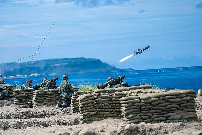 A photo from Taiwan's Military News Agency shows a military drill on the beach in Pingtung county in southern Taiwan. The drill is part of the annual Han Kuang military exercises, held to test Taiwan's defence against a hypothetical attack by China.