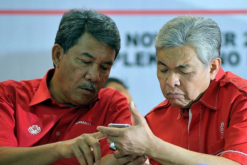 Umno officials Mohamad Hasan (left) and Ahmad Zahid Hamidi in a 2018 photo. Zahid, the party's president, is on leave after being charged over various offences, and Datuk Seri Mohamad is the party's acting president. PHOTO: BERNAMA