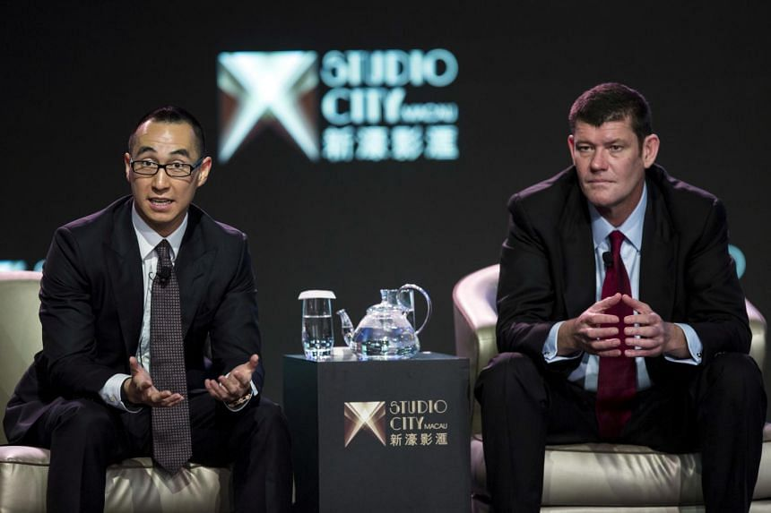 Australian billionaire James Packer's (right) investment company, Consolidated Press Holdings, said that the sale to Hong Kong gambling mogul Lawrence Ho's Melco Resorts and Entertainment involved 19.99 per cent of Crown Resorts.