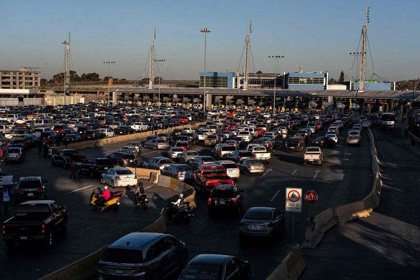 Cars line up to cross to the United States at San Ysidro port of entry, as seen from Tijuana, Baja California state, Mexico, on Nov 9, 2018.