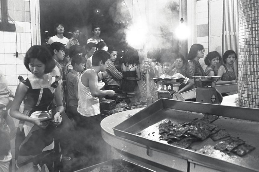 Chinese New Year shoppers queuing up at a stall in Mosque Street, Chinatown.