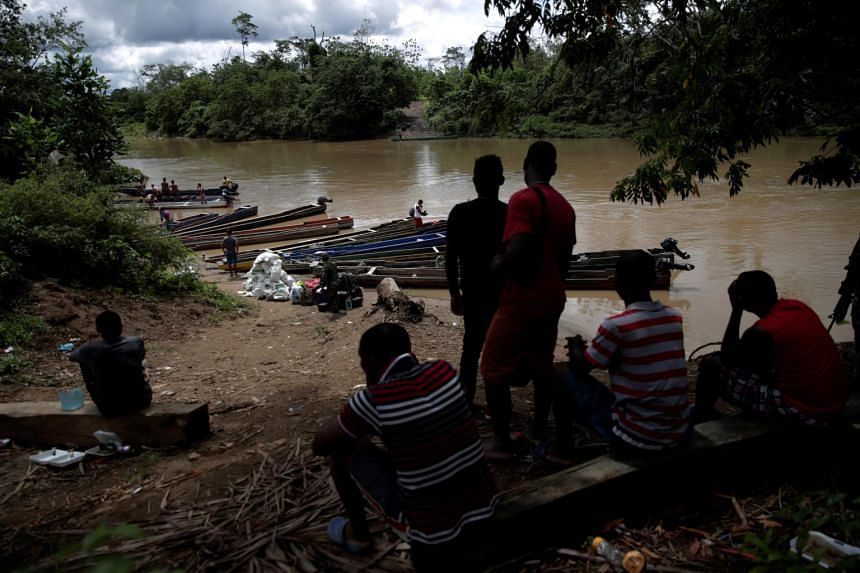 Migrants from different countries on the banks of the Chucunaque River near a temporary humanitarian campsite in the village of Penita, Darien, Panama, on May 22, 2019.