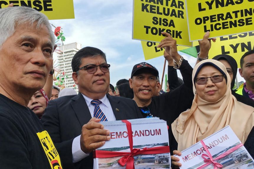 Ms Fuziah Salleh, the member of Parliament for Kuantan in Pahang (right) said Prime Minister Mahathir had commented that a condition for renewing the licence was for Lynas to first ship back to Australia the waste produced at its Malaysian plant.