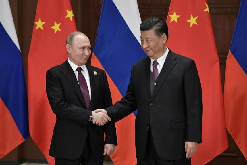 Russian President Vladimir Putin meets Chinese President Xi Jinping at Friendship Palace in Beijing on April 26, 2019, on the sidelines of Belt and Road Forum.