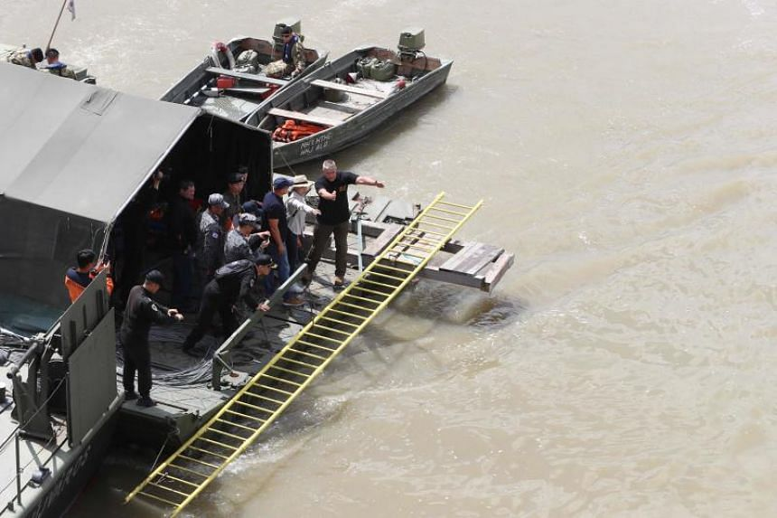 A South Korean delegation arrives at the spot of a boat accident on the Danube river in Budapest on May 31, 2019.
