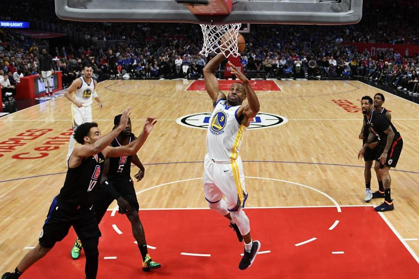 Andre Iguodala of the Golden State Warriors drives to the basket for a dunk during the game against the Los Angeles Clippers, on April 21, 2019.