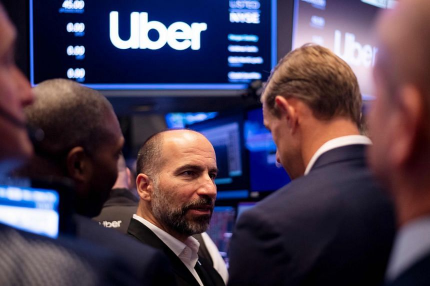 Dara Khosrowshahi talks to traders after the opening bell during Uber's IPO at the New York Stock Exchange.