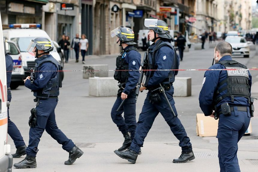 Police work near the site of the attack in central Lyon, May 24, 2019.